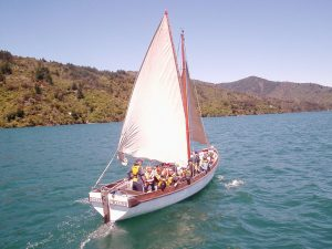 Sailing on a cutter during Outward Bound, Marlborough Sounds New Zealand